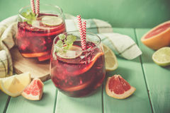 Sangria and ingredients in glasses Stock Photos