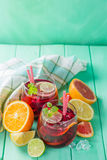 Sangria and ingredients in glasses Royalty Free Stock Photos