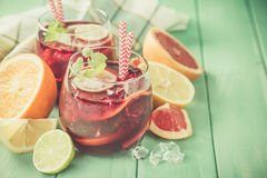 Sangria and ingredients in glasses Royalty Free Stock Images