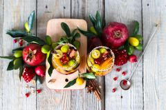 Sangria with pomegranate, pear, orange, kumquat and spices. stock images