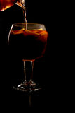 Sangria pouring. Pouring a chilled sangria with fresh fruit Stock Image