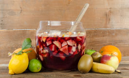 Sangria punch bowl with fruits Stock Images