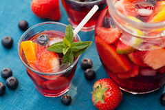 Sangria. Refreshing sangria (punch) with fruits stock images