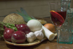 Sangria still. With onions vintage bottles and fresh vegetables royalty free stock images