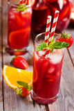 Sangria. With strawberry, mint and orange in glasses and pitcher. Selective focus Stock Photo
