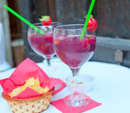 Sangria in two glasses on a table in cafe Stock Photos