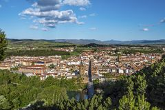 Sanguesa city scape. Panorama of Sanguesa city in Spanish Navarre. Aragon river and the city entrance via the bridge are at foreground Stock Image
