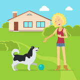 Sanguine Temperament Type Girl with Dog. Sanguine temperament type girl playing on the yard with her adorable dog. Happy and cheerful woman having fun with pet Stock Photos