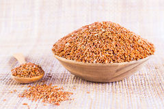 Sangyod brown GI rice in a wooden bowl. Product of Thailand Stock Image
