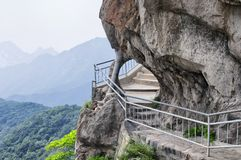 Songshan Mountain Range and geological formations China. The sanhuang plank way secured to the cliff side on Mount Song in Henan Province China stock photos