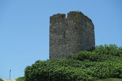 Sani Tower Halkidiki, Greece. Remains of tower standing on Sani Hill, above the luxury resort, is also known as Stavronikita tower stock photography