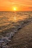 Sanibel för solnedgångbågskyttstrand ö Florida Arkivbilder
