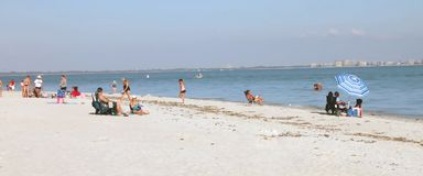 Sanibel Island Beach. View of Sanibel Island Beach in Florida with people enjoying and relaxing on the beach in a sunny day with blue sky and white sand stock photography