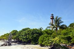 Sanibel Island Florida Lighthouse 1. Sanibel lighthouse from the beach with palm tree and mangrove shoreline in foreground stock photography