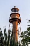 Sanibel Light Through Palms - Sanibel Island Lighthouse, Florida. The lighthouse on Florida's Sanibel Island is seen through palm fronds stock photos