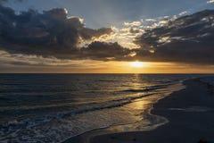Sanibel at Sunset - Sanibel Island, Florida. Gentle waves roll in on a sandy beach just before sunset on Sanibel Island along the Gulf Coast of Florida royalty free stock photo