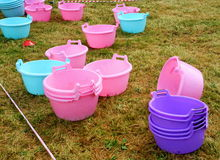 Sanitary basins. plumbing plastic multi-colored blue pink purple pots used for team training programs in business team building Stock Photo