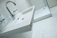 Sanitary with with chromium faucet and white bathroom Stock Images