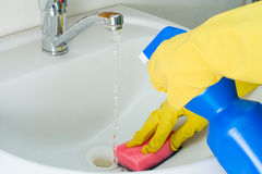 Sanitary clearing of a sink. Disinfection and sanitary clearing of a sink Royalty Free Stock Photos