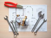 Free Sanitary Engineering. Water Meters And Tools For Plumbing. Stock Photo - 114872040
