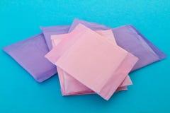 Sanitary napkin. S on blue background Stock Photo