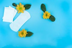 Sanitary napkin with copy space on light blue background royalty free stock image