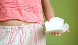 Sanitary pad. A sanitary pad in a woman hand Stock Photography