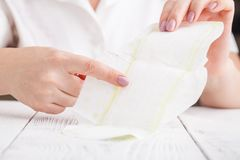 Sanitary pad in hands of woman royalty free stock photo