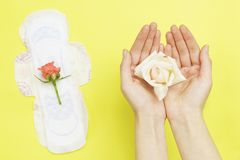 Sanitary pad on yellow isolated background. stock photos