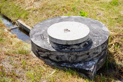 Sanitary sewer cover Royalty Free Stock Photos