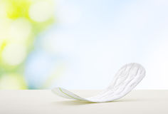 Sanitary towel. Close up view of woman's sanitary pad on color back Stock Photos