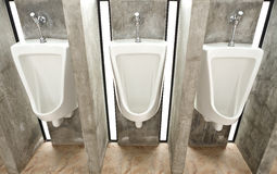 Sanitary ware in men's restroom Royalty Free Stock Images