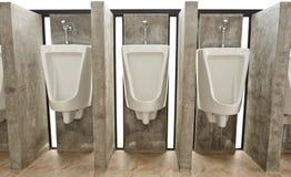 Sanitary ware in men's restroom Royalty Free Stock Image
