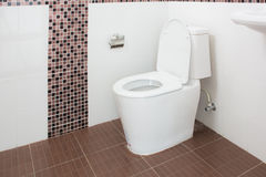 Sanitary Ware New Bathroom white toilet Stock Image