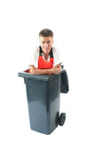 Sanitation. Young woman in a garbage can stock photography
