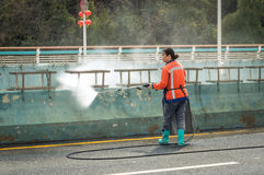 Sanitation workers—washing city streets Royalty Free Stock Images