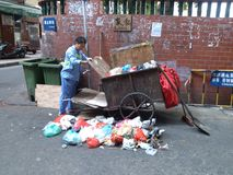 Sanitation workers cleaning up litter Royalty Free Stock Photos