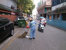 Sanitation workers cleaning up litter Stock Photo