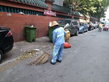Sanitation workers cleaning up litter Stock Images
