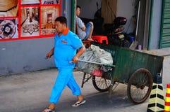 Sanitation workers dragging garbage truck Royalty Free Stock Photos