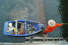 Sanitation workers in the river clean up garbage Stock Images
