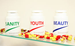 Sanity, Beauty And Youth Pills In A Bottle Royalty Free Stock Photos