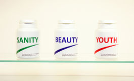 Sanity, Beauty and Youth pills in a bottle Royalty Free Stock Photography