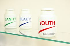 Sanity, Beauty and Youth pills in a bottle Stock Photo