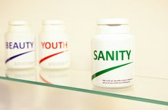 Sanity, Beauty and Youth pills in a bottle Royalty Free Stock Image