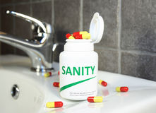 Sanity pills in a bottle Royalty Free Stock Images