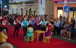 Sanjoaninas festivities, Angra do Heroismo, Terceira island, Azores. ANGRA DO HEROISMO, AZORES, PORTUGAL - JUNE 23, 2017: Traditional evening parade of Royalty Free Stock Photography