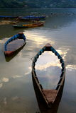 Sank into the evening sunset in pokhara. Two boats sank at the local lake in pokhara Royalty Free Stock Images