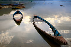 Sank into the evening sunset in pokhara. Two boats sank at the local lake in pokhara in nepal Stock Images