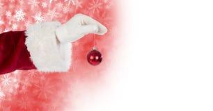 Sankt, die Flitterdekoration und Schneeflocken-Weihnachtsmuster und Leerstelle hält Lizenzfreies Stockbild